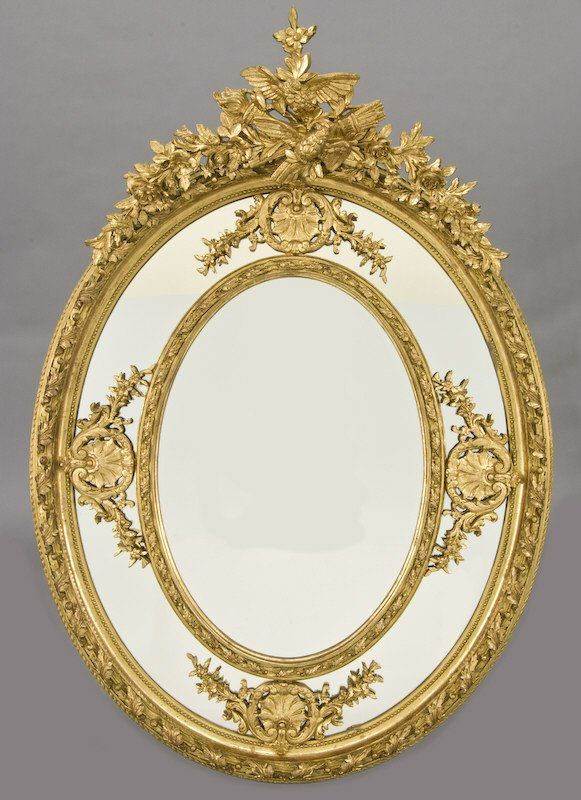 Large French Louis XV style oval gilt wood mirror