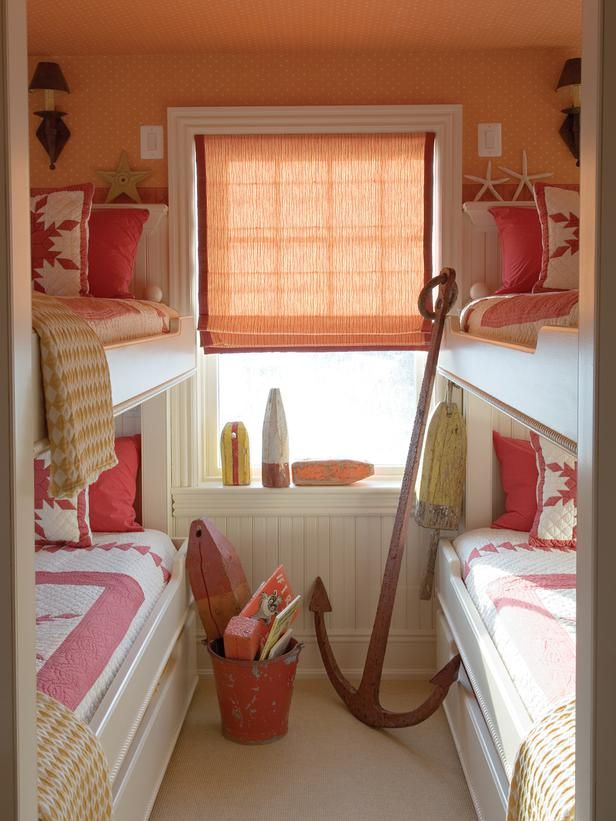 BBBBB Beachy Trundle Bunks  This kids room can sleep up to six youngsters with a pair of trundle bunk beds. Seaside antiques found in local shops and Country Swedish wallpaper adds to the charm. ©Gibbs Smith, Barry Dixon Interiors, Brian D Coleman. Design: Barry Dixon/Photo: Edward Addeo