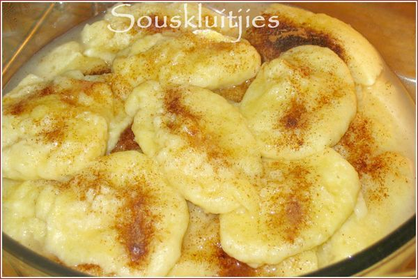 This traditional South African recipe for souskluitjies is pure comfort food - pillowy cinnamon dumplings in a sweetly spiced sauce.