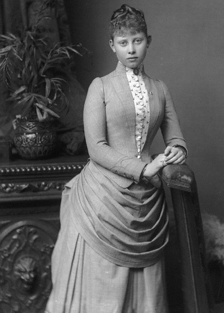 Mossy, 1887.  Her cousin Nicky (later Tsar Nicholas II) balked at the suggestion that he consider her as a marriage prospect because he found her to be ugly.  But I think she is charming here, with a shy gentle face.