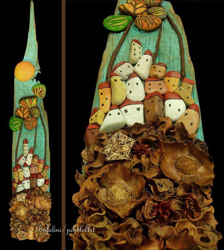 - Paesaggio arroccato realizzato mediante assemblaggio di sassi dipinti, particolari di legno, foglie e fiori secchi  - Landscape perched realized b...