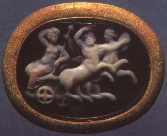 Dionysos on his chariot, drawn by centaurs.  Sardonyx. 1st century B.C.  2.3 × 3.1 cm.