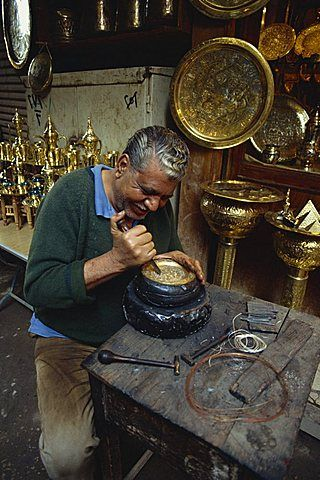 Portrait of a craftsman at work in a copper souk, Khan el Khalili Bazaar, Cairo, Egypt