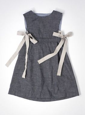 Sweet pinafore dress with side ties. Look for a pattern to make something like this.