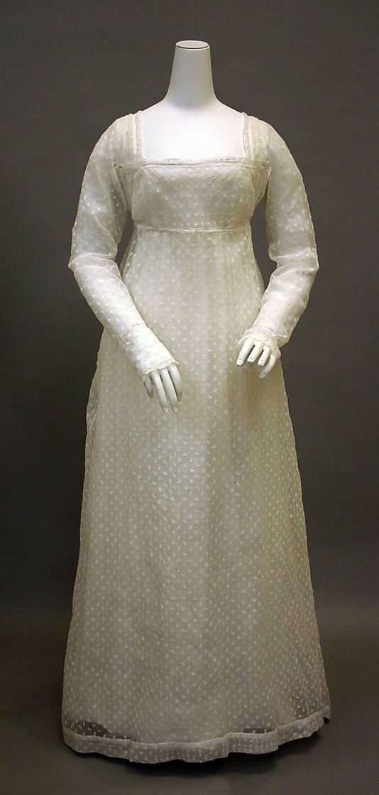 Cotton dress, ca. 1800, French. In the Metropolitan Museum of Art costume collection. (Bib front gown, all over embroidery - looks like eyelet design along edge of bodice bib and sleeves)