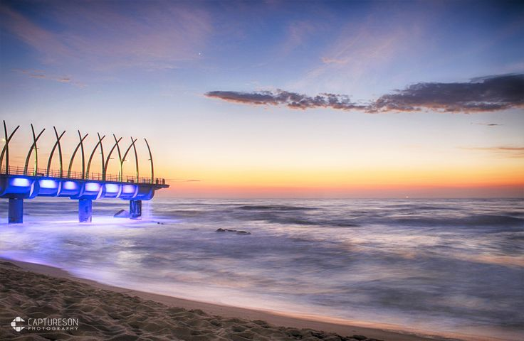 The Umhlanga Pier isn't just a place to grab a great photo, it's an extension of an underground culvert that helps disperse excess storm water from the land into the ocean.  #sunrise #sea #water #beach #travel #clouds #coast #ocean #waves #pier #sand #seascape #longexposure #durban #south africa