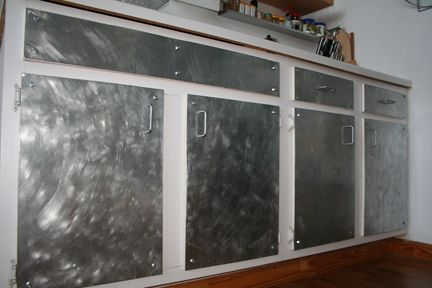 Is this ugly? I saw this online somewhere what do you all think? It s galvanized sheets ontop of exsisting cabinet doors.
