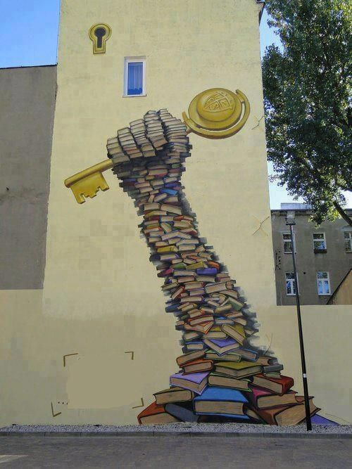 Reading on the streetStreet art - Education is the key to knowledge RIF