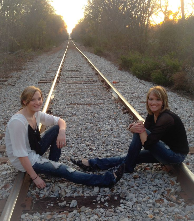 Mother daughter photo shoot....symbolic railroad pose that depicts their journey together through life