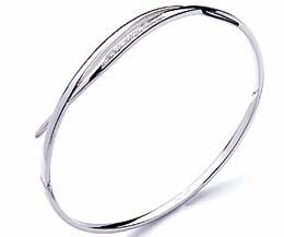 "Similar to my ""Hot Diamonds"" bracelet -  which is a staple to my daily outfits; dress or jeans."
