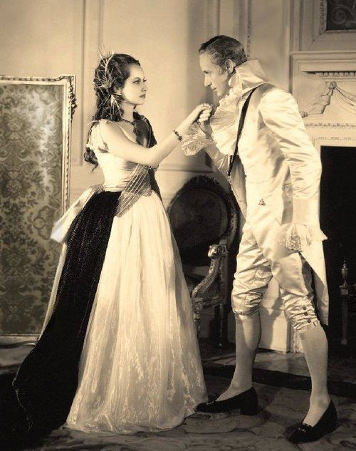 """Marguerite (Merle Oberon) and Sir Percy (Leslie Howard) in """"The Scarlet Pimpernel"""""""