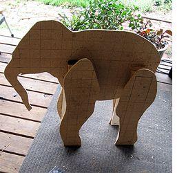 paper mache baby elephant sculpture