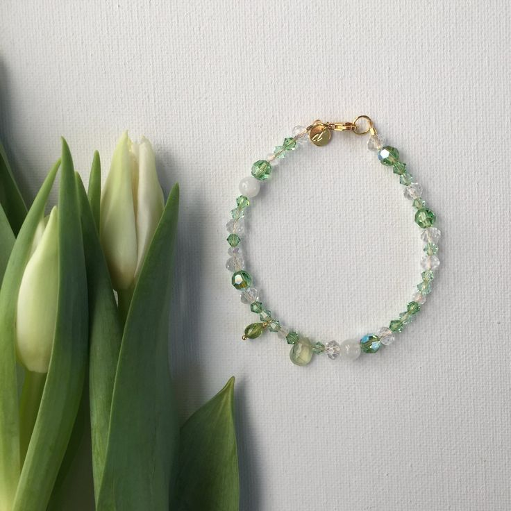 She's a shoulder to lean on, she'll share a cup of tea and lend an ear. A nurturer and caretaker. This bracelet is a fresh, vibrant palette of green and white accented withMoonstone to bring good fortunePeridot for compassionPrehnite for protectionfinished with 22-24kt gold-plated wire