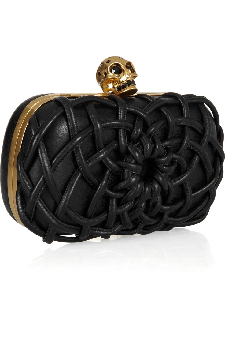 This Alexander McQueen skull box clutch means business.  This belongs in the hands of a woman who is rockin' a serious cocktail ring.
