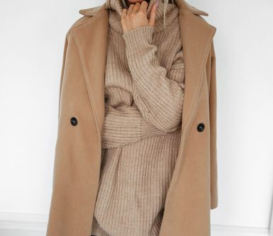 love the camel coat layered over the cozy sweater