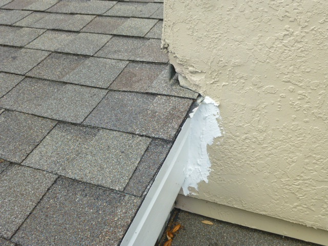 New stucco cladding with caulking patch Cladding