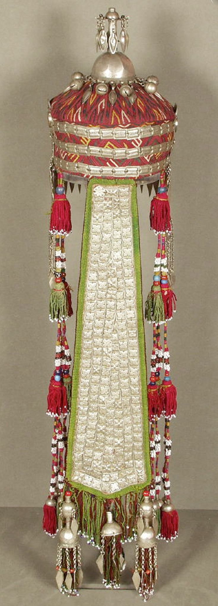 Turkmenistan | Bridal headdress; Cotton cap embroidered with silk and ornamented with silver, carnelian, silk tassels and beads | Turkmen, Yomut Tribe | 19th to early 20th century