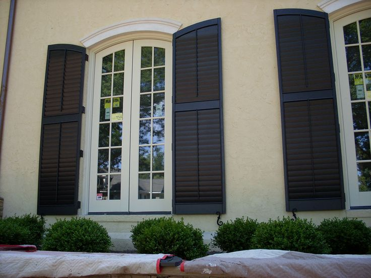 Outdoor Window shutters | ... Window Shutters: The Best Window Treatment: Exterior Window Shutters, buttercream with off-white and black/brown shutters