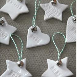 Stamped ceramic decorations w. tiny bells.