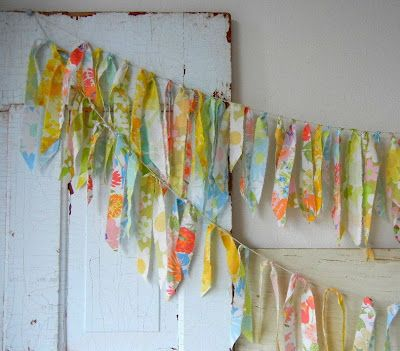 Bunting made with strips of vintage sheets tied onto string.