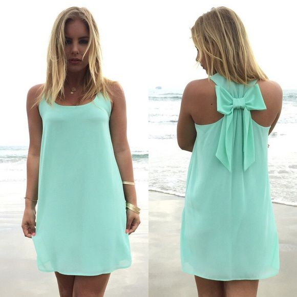 BOGO NWOT Mint Blue Bow Back Dress Summery, breezy bow back dress made of chiffon and fully lined. Perfect for summer or layer up with a sweater for fall days. First photo is for style inspiration, second and third photos are what is being sold. Please DO NOT BUY THIS LISTING! When you're ready to purchase, comment with your size and I will make a listing for you (Small or Medium). Price is firm and no trades please! Boutique Dresses