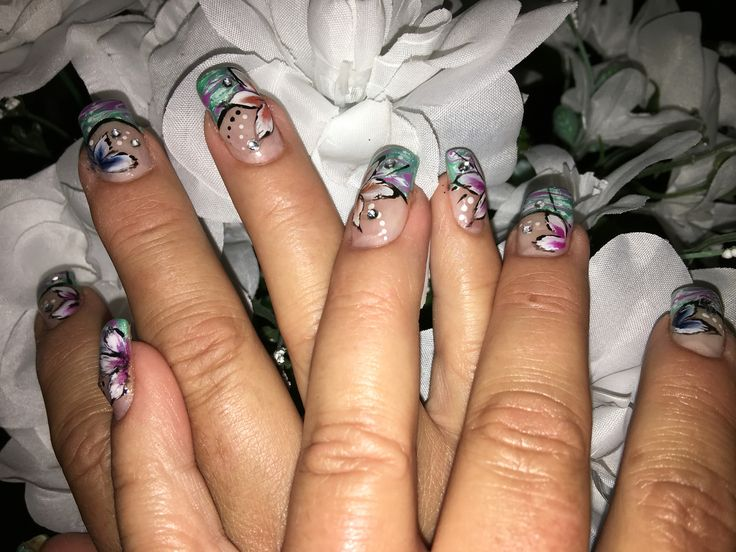 Green pink nails with one stroke art flowers with gem accents gel nails.