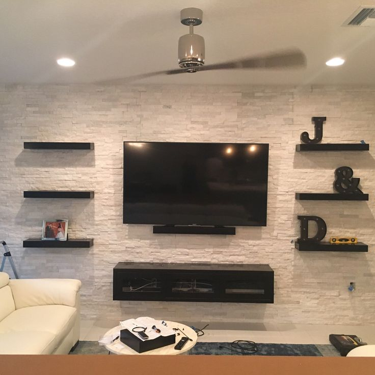 tv on wall with shelves. espresso floating entertainment center and shelves we custom built for client. tv on wall with l