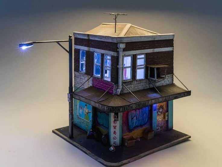 Black Shadow Trading cie - miniature light up building with graffiti street art | From a unique collection of still-life sculptures at https://www.1stdibs.com/art/sculptures/still-life-sculptures/