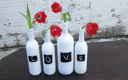 Wine, Beer, and Soda Bottles (hopefully free from family and friends!) White spray paint $2 for 8 bottles. Chalk board paint $2 for 12 bottles. Chalk $0.99 Dollar Tree (or use white paint) 4 tulips or any flower depending on budget.  About $4.50-$5 each (if tulips are in season. If not, go with something else.