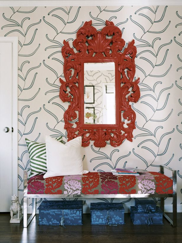 The Psychology of Color: Choose the Right Shade.  Red-Orange: A Subtle Approach  The red-orange mirror counterbalances the cool blue patterned wallpaper and instantly warms the space. Use small doses of red if you want to spice things up without completely committing to the bold hue. Design by Erinn Valencich