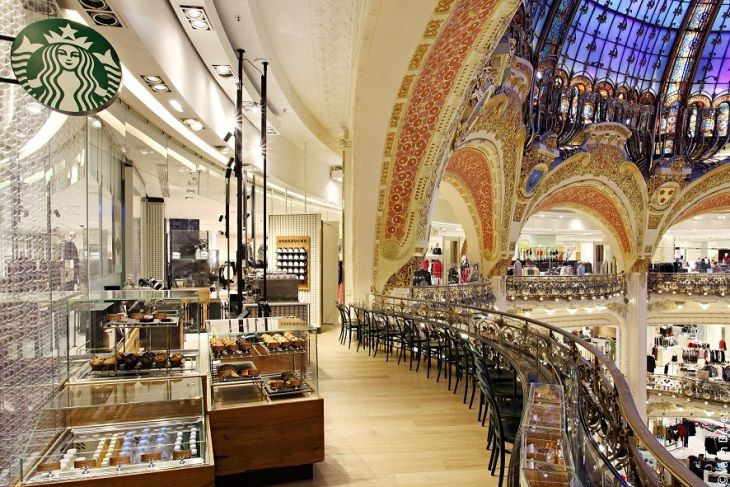 The Starbucks store within Paris' Galeries Lafayette takes its inspiration from the world of fashion that defines the legendary department store. It is crafted with locally sourced wood and black marble, brass, glass, and metal.