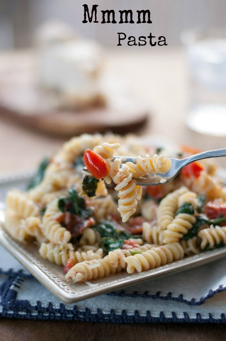 Fusilli pasta with spinach, Asiago cheese, and cherry tomatoes