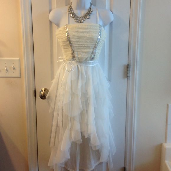 Brand new junior size 7, white dress Brand new I'm dress, junior size 7, white high/low, above the knee, made of polyester nylon, zipper on the back, prom special occasion dress Im dress Dresses Prom
