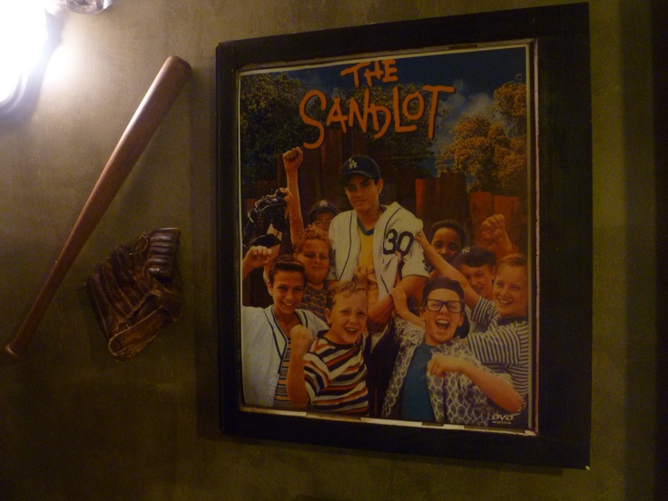 Old window frame used as a frame for a movie poster in our sports themed basement.