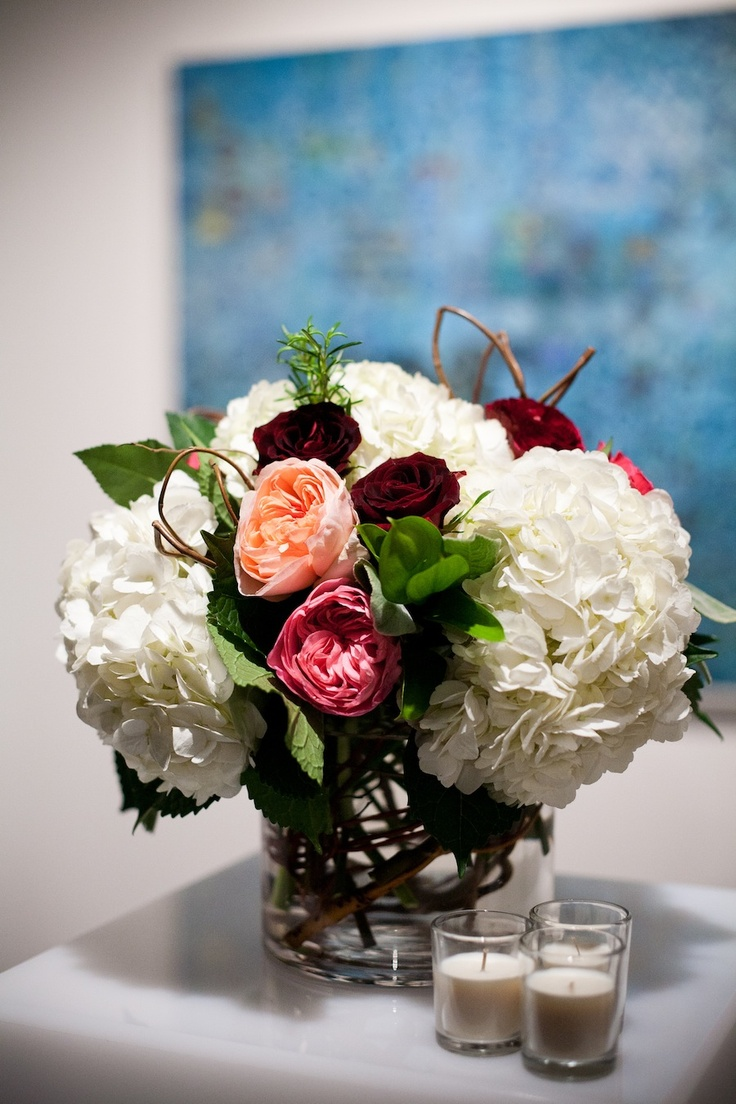 White hydrangea and garden rose centerpiece with curly