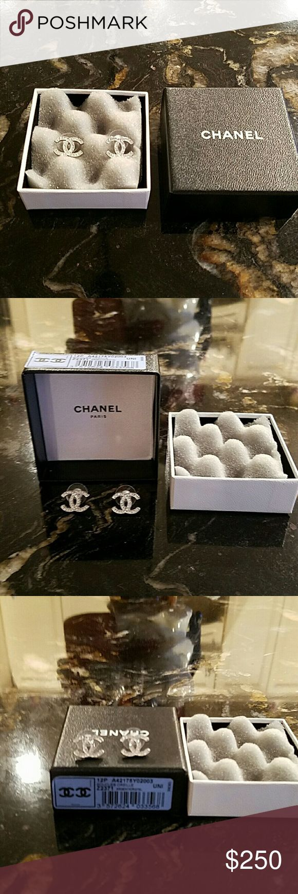 Authentic CHANEL Earrings Never worn CC Silver crystal earrings. Comes with original box with bar code. CHANEL Jewelry Earrings