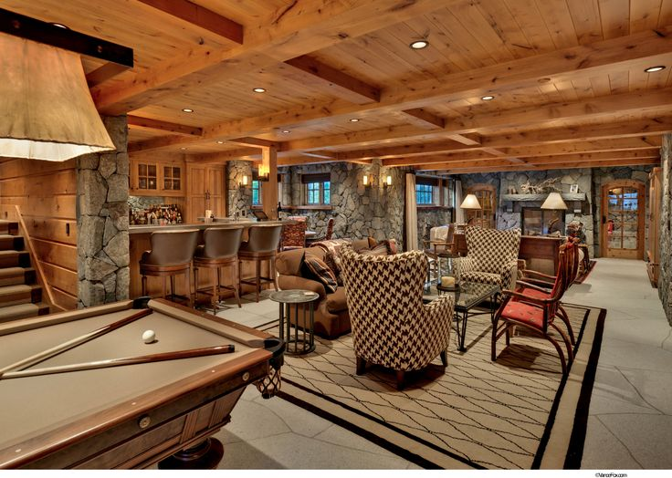 Walk out basement with bar several seating areas and pool for Log cabin basement ideas