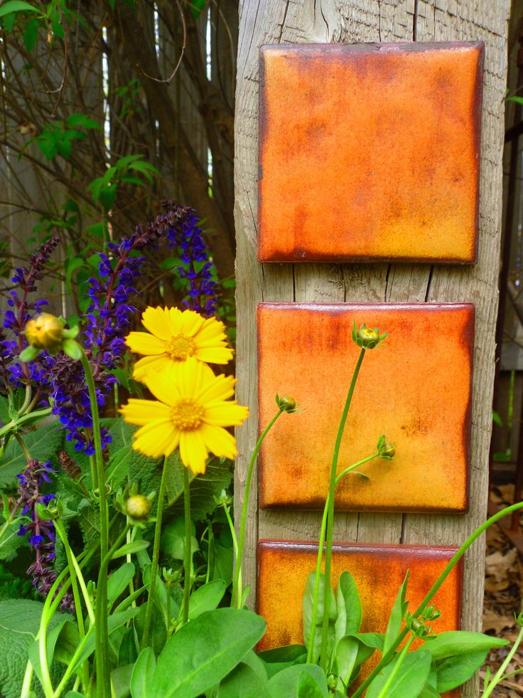 "From gardendrama.com: ""Kitchen and bath tiles, attached to a 4 x 4 fence post with Liquid Nails or secured with small nails, add color, flair and visual appeal."""