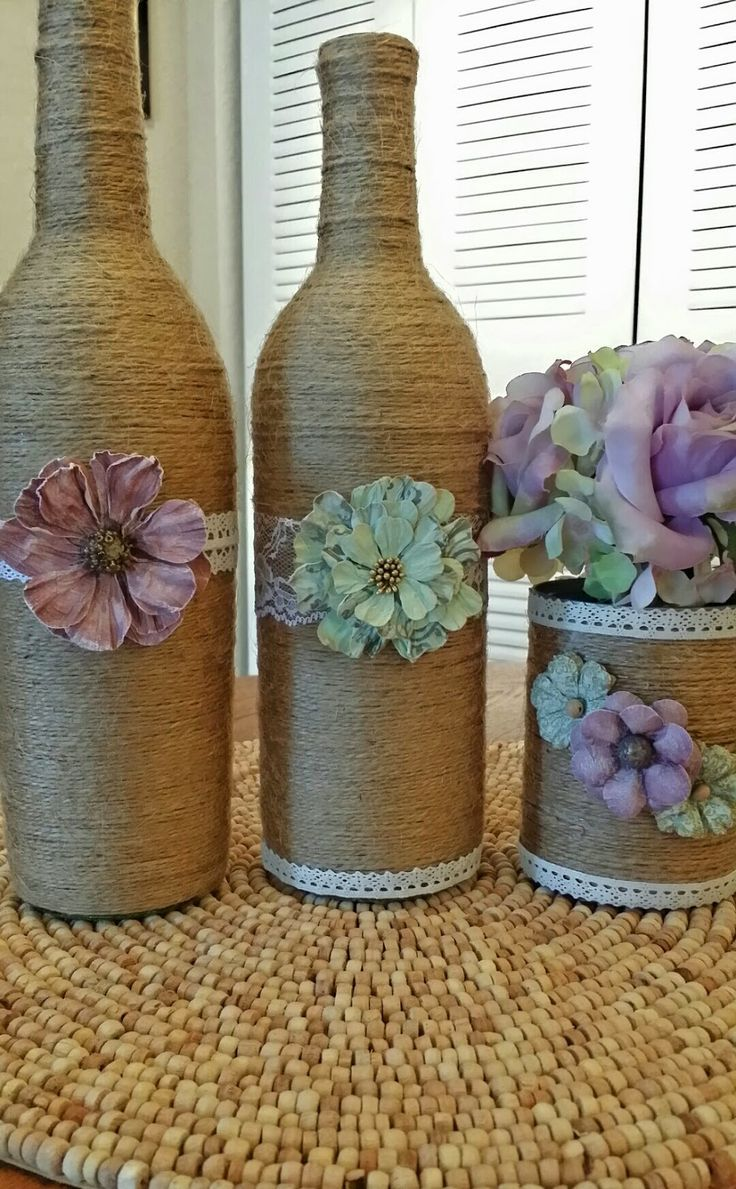 upcycled twine-wrapped wine bottles, http://www.coolcrafts.com/upcycled-wine-bottle-crafts/