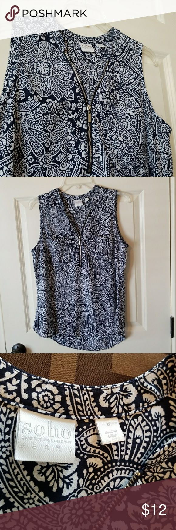 """NY&CO sleeveless top Soho jeans / New York & company sleeveless shirt featuring front zipper and two decorative  Slip pockets at bust. Patterned navy blue and white. 100% polyester,  machine wash. No flaws.  20"""" pit to pit New York & Company Tops Tank Tops"""