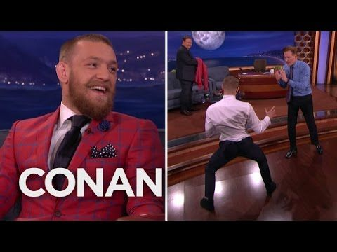 """CONAN Highlight: Conor thinks he might break out his Meia Lua kick on Nate Diaz and """"ping it across his head,"""" but not before he nearly does it to Conan. Mor..."""