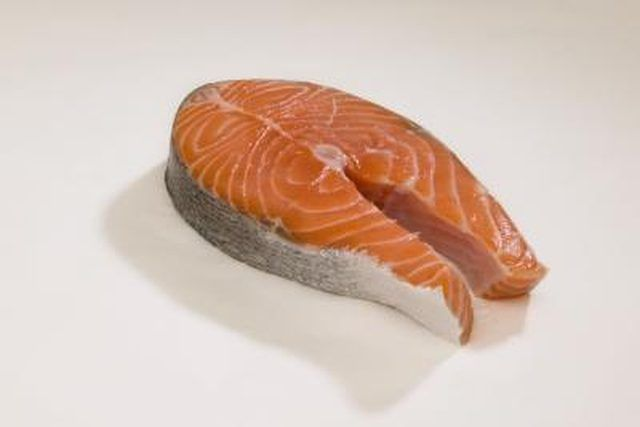 Salmon steaks result from making vertical cuts all the way through the fish, as opposed to removing the fillets and trimming them down to single portions. The resulting cut of fish contains a portion of both filets, and resembles a beef steak in shape and thickness — salmon steaks are commonly 1 to 2 inches …