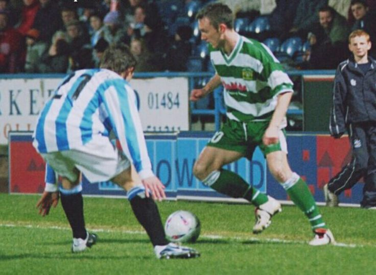 Huddersfield 3 Yeovil Town 1 in March 2004 at the McAlpine Stadium. Gavin Williams takes on Andy Holdsworth in the Division 3 clash.