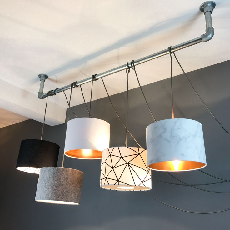 A cluster of our Scandi and Geometric inspiried pendant lampshades hung on our industrial bar using a 5 way multi ceiling rose kits. Black ceiling rose and lots and lots of grey lighting cable.