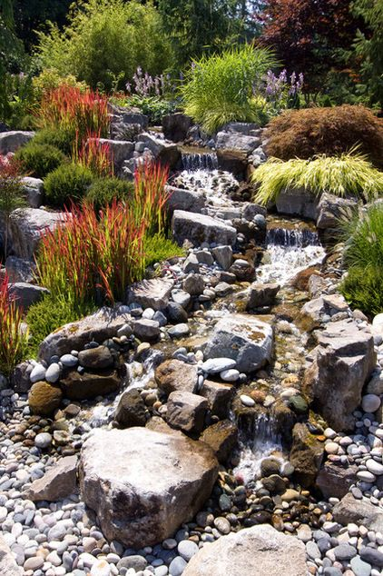 Create a dry creek bed water feature in your back yard.  Rustic landscape by Pacifica Landscape Works Inc. #garden #diy