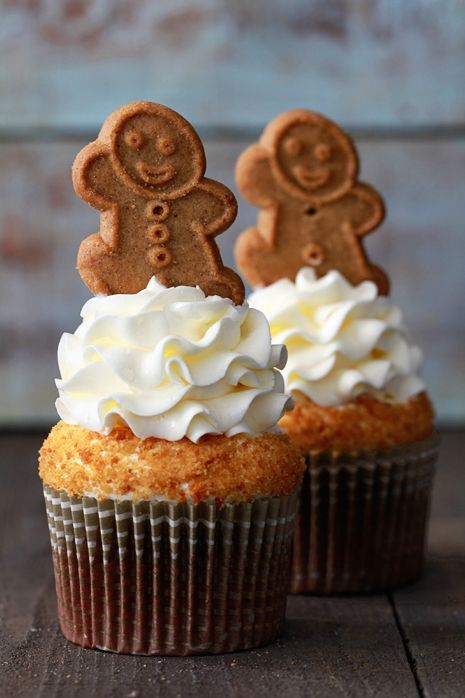 Gingerbread Latte Cupcakes with Lemon Cream Cheese Frosting Recipe from Bakers Royale.  Love the little gingerbread man cookie on top.