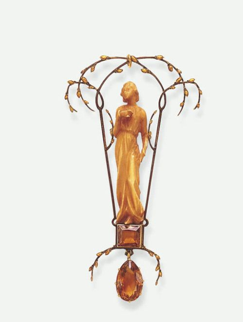 """turnofthe20th: """" Lalique ivory and citrine pendant mounted in gold, ca. 1900 """""""