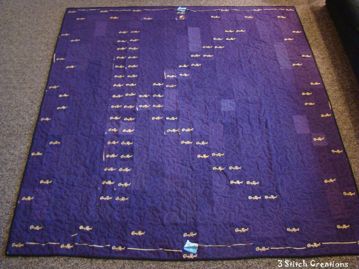 A fun quilt request - this is made from their crown royal bags.  The K is for their last name.