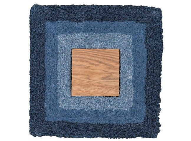 A geometric, soft linen carpet with an integrated wooden board in the center.