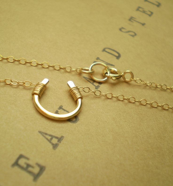 Tiny Luck Necklace - Tiny Hand Formed Gold Filled Horseshoe on Delicate Gold Filled Chain. $34.00, via Etsy.